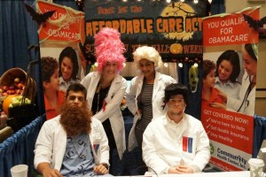 CHC staff & AmeriCorps sitting at the Expo booth in full costume!